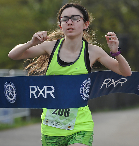 Alison Briggs, 20, of Commack crosses the finish line to win the female competition in the inaugural 1-mile race as part of Long Island Marathon Weekend at Eisenhower Park on Saturday, May 5, 2018.