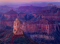 749220208 dawn light filters over the north rim of the grand canyon and shades mount hayden and surrounding canyons with a diffused warm glow