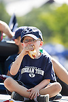 12FTB vs Weber State 4566<br /> <br /> 12FTB vs Weber State, Kid with glasses, Child, Eating hot dog, Tailgating before football game outside of LVES Lavell Edwards Stadium.<br />  <br /> BYU-45<br /> Weber ST-13<br /> <br /> Photo by Jonathan Hardy/BYU<br /> <br /> September 8, 2012<br /> <br /> &copy; BYU PHOTO 2012<br /> All Rights Reserved<br /> photo@byu.edu  (801)422-7322
