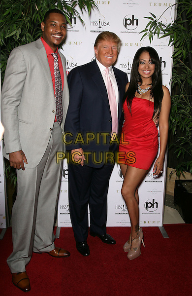 CARMELO ANTHONY, DONALD TRUMP & LALA VAZQUEZ.2010 Miss USA Pageant at the Planet Hollywood Resort Hotel and Casino, Las Vegas, Nevada, USA..May 16th, 2010.full length grey gray suit red dress shirt couple blue white pink tie.CAP/ADM/MJT.© MJT/AdMedia/Capital Pictures.