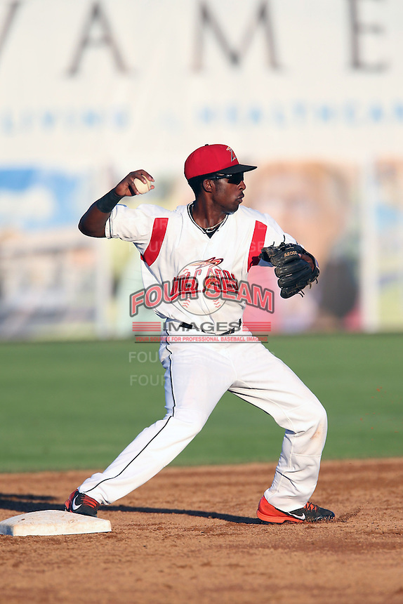 Travious Relaford #6 of the Salem-Keizer Volcanoes during a game against the Spokane Indians at Volcanoes Stadium on July 26, 2014 in Keizer, Oregon. Spokane defeated Salem Keizer, 4-1. (Larry Goren/Four Seam Images)