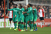Watford celebrate their first goal in the first half scored by Will Hughes (centre) during Woking vs Watford, Emirates FA Cup Football at The Laithwaite Community Stadium on 6th January 2019