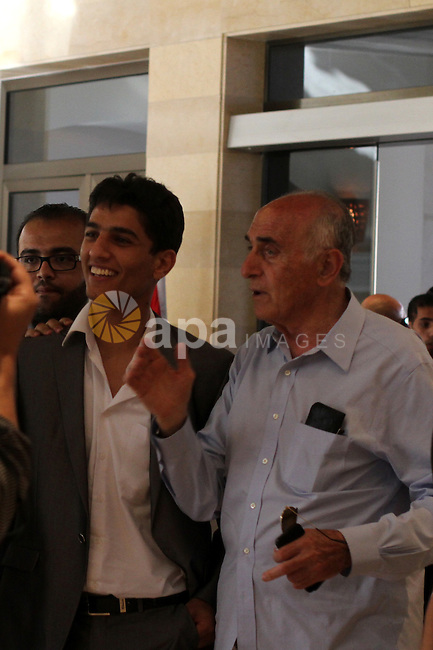 Arab Idol winner Palestinian Mohammed Assaf arrives to the Gaza Strip, on June 25, 2013. Thousands of Gazans gave an ecstatic welcome to Mohammed Assaf as the 23-year-old Palestinian singer returned home after winning this year's Arab Idol talent competition. Photo by Ashraf Amra