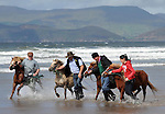 A group of Kerry Bog ponies are taken for their annual 'bath in the sea' at Rossbeigh Beach in County Kerry. Photo: Don MacMonagle