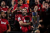 Sam Whitelock captain of the Crusaders celebrates with the trophy following the final whistle in the 2018 Super Rugby final between the Crusaders and Lions at AMI Stadium in Christchurch, New Zealand on Sunday, 29 July 2018. Photo: Joe Johnson / lintottphoto.co.nz