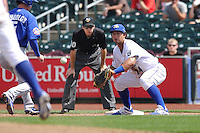 Cheslor Cuthbert #24 of the Omaha Storm Chasers waits for the ball on a pickoff attempt at first base against the Las Vegas 51s at Werner Park on August 17, 2014 in Omaha, Nebraska. The Storm Chasers  won 4-0.   (Dennis Hubbard/Four Seam Images)
