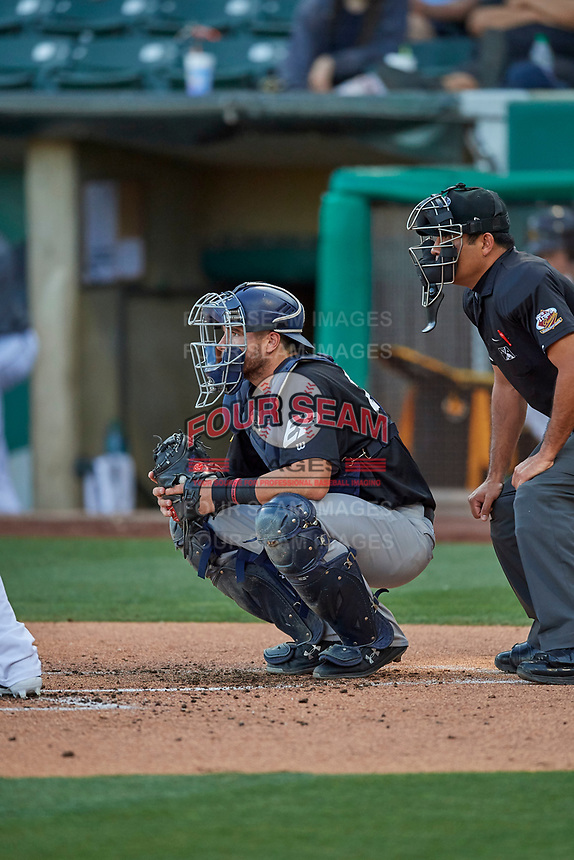 Austin Allen (27) catcher of the El Paso Chihuahuas on defense against the Salt Lake Bees at Smith's Ballpark on August 17, 2019 in Salt Lake City, Utah. The Bees defeated the Chihuahuas 5-4. (Stephen Smith/Four Seam Images)
