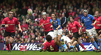 27/03/2004  -  RBS Six Nations Championship 2004 Wales v Italy.Italy's scrum half Paul Griffen passes the ball out from the ruck.   [Mandatory Credit, Peter Spurier/ Intersport Images].