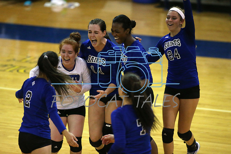 The Marymount Saints react to a play in a college volleyball game against St. Mary's, in Lexington Park, MD, on Wednesday, Oct. 29, 2014. Marymount won 3-2 to go 24-9 on the season.<br /> Photo by Cathleen Allison
