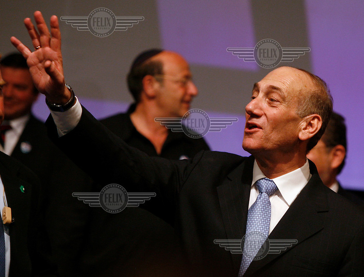Acting Prime Minister Ehud Olmert celebrating his Kadima party's victory in the election.