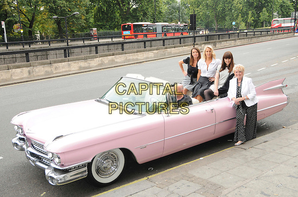 KEREN WOODWARD, SARA DALLIN,  MELANIE CHISHOLM & GLORIA HUNNIFORD.The PINKTOBER Concert launch, Hard Rock Cafe, Piccadilly, London, England..September 7th, 2009.mel c karen sarah full length pink grey gray cadillac car sitting black white dress shirt jacket polka dot dress .CAP/CAS.©Bob Cass/Capital Pictures.