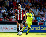 Paul Coutts of Sheffield Utd gets clear of Marcus Olsson of Derby County during the Championship match at Bramall Lane, Sheffield. Picture date 26th August 2017. Picture credit should read: Simon Bellis/Sportimage