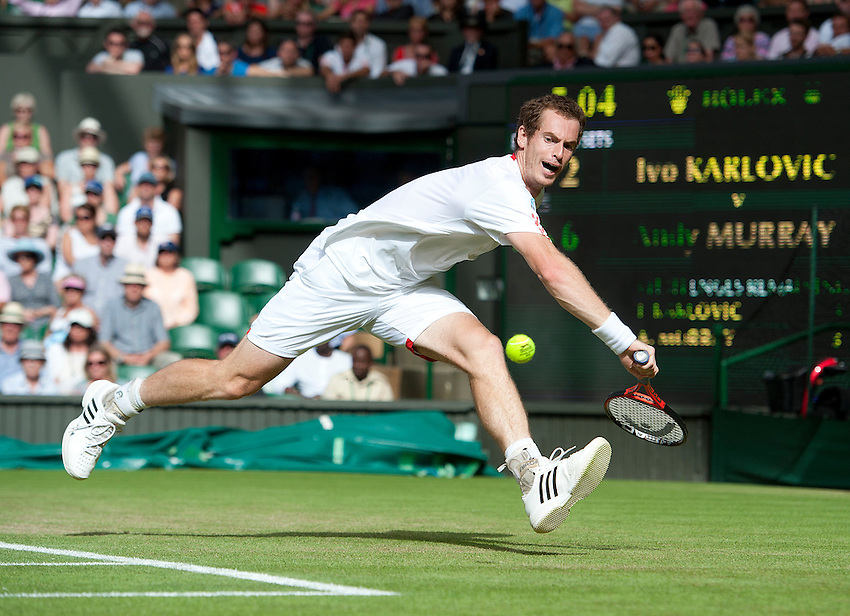 Andy Murray GBR (4) in action today during his victory over Ivo Karlovic CRO in their Gentlemen's Singles Second Round match - Andy Murray GBR (4) def Ivo Karlovic CRO 7-5 6-7(5) 6-2 7-6(7)..Tennis - Wimbledon Lawn Tennis Championships - Day 4 - Thursday 28th June 2012 -  All England Lawn Tennis and Croquet Club - Wimbledon - London - England..© CameraSport - 43 Linden Ave. Countesthorpe. Leicester. England. LE8 5PG - Tel: +44 (0) 116 277 4147 - admin@camerasport.com - www.camerasport.com.