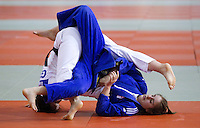 27 MAR 2011 - SHEFFIELD, GBR - Demi Brooks (white) v Natasha Maslen (blue) - English Senior Open Judo Championships .(PHOTO (C) NIGEL FARROW)