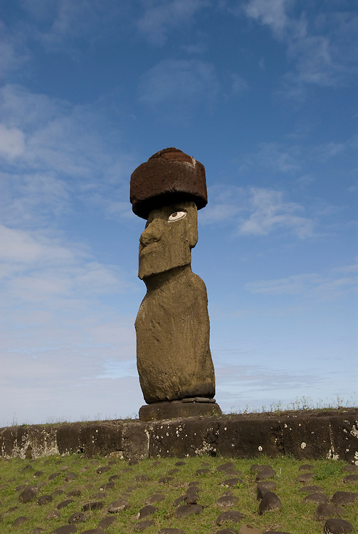 Chile, Easter Island: Statue or moai on a platform or ahu known as Ahu Tahai, near the town of Hanga Roa.  This statue is unique because it is the only one fully restored with a topknot and eyes..Photo #: ch212-33608.Photo copyright Lee Foster www.fostertravel.com lee@fostertravel.com 510-549-2202