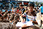 Axel Domont (FRA) AG2R La Mondiale with young fans at sign on before the start of Stage 2 of the 2018 Criterium du Dauphine 2018 running 181km from Montbrison to Belleville, France. 5th June 2018.<br /> Picture: ASO/Alex Broadway | Cyclefile<br /> <br /> <br /> All photos usage must carry mandatory copyright credit (&copy; Cyclefile | ASO/Alex Broadway)