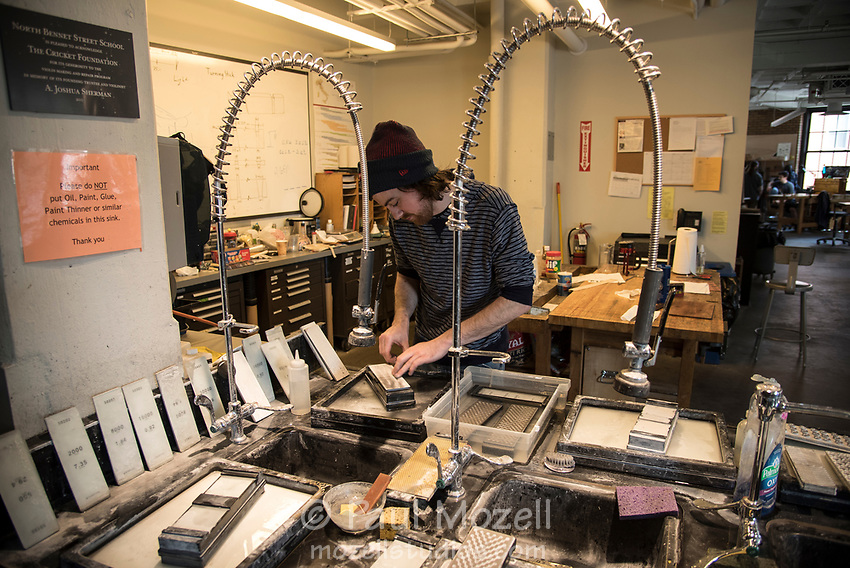 Student Chris Henderson of The Violin Making and Repair program at the North Bennett Street School uses an array of sharpening stones to maintain his carving and cutting tools.