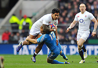 Manu Tuilagi is tackled in possession. RBS Six Nations match between England and Italy on March 10, 2013 at Twickenham Stadium in London, England. Photo by: Patrick Khachfe / Onside Images