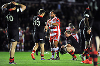 John Afoa of Gloucester Rugby shakes hands with Sam Beard of Edinburgh Rugby after the match. European Rugby Challenge Cup Final, between Edinburgh Rugby and Gloucester Rugby on May 1, 2015 at the Twickenham Stoop in London, England. Photo by: Patrick Khachfe / Onside Images