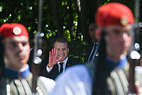 Pictured: French President Emmanuel Macron as seen through the Presidential Guards outside the Presidential Mansion in Athens, Greece. Thurday 07 September 2017<br /> Re: The official welcome of French President Emmanuel Macron for his state visit to Athens, Greece.