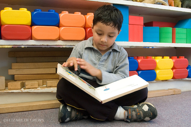 Berkeley CA  Latino boy studying book in class.
