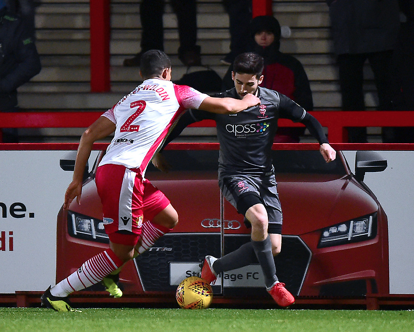 Lincoln City's Tom Pett vies for possession with Stevenage's Luther Wildin<br /> <br /> Photographer Andrew Vaughan/CameraSport<br /> <br /> The EFL Sky Bet League Two - Stevenage v Lincoln City - Saturday 8th December 2018 - The Lamex Stadium - Stevenage<br /> <br /> World Copyright © 2018 CameraSport. All rights reserved. 43 Linden Ave. Countesthorpe. Leicester. England. LE8 5PG - Tel: +44 (0) 116 277 4147 - admin@camerasport.com - www.camerasport.com