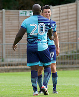 Adebayo Akinfenwa of Wycombe Wanderers (20) congratulates Luke O'Niel of Wycombe Wanderers  on his second goal of the game to make it 1-3 during the Friendly match between Maidenhead United and Wycombe Wanderers at York Road, Maidenhead, England on 30 July 2016. Photo by Alan  Stanford PRiME Media Images.
