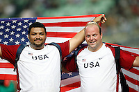 Reese Hoffa(left) won the Shot Put Gold medal with a toss of 22.04m and Adam Nelson(right) won the Silver medal with a toss of 21.61m at the 11th. IAAF World Championship being held in Osaka, Japan. Photo by Errol Anderson, The Sporting Image.