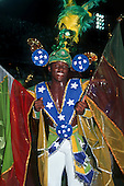 Rio de Janeiro, Brazil. Samba dancer in costume themed on the Brazilian flag during the carnival parade.