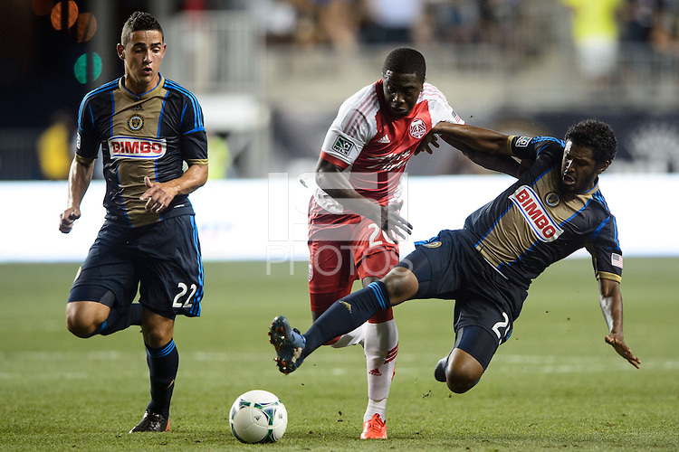 Sheanon Williams (25) of the Philadelphia Union goes for a tackle on Jose Valencia (20) of the Portland Timbers. The Philadelphia Union and the Portland Timbers played to a 0-0 tie during a Major League Soccer (MLS) match at PPL Park in Chester, PA, on July 20, 2013.