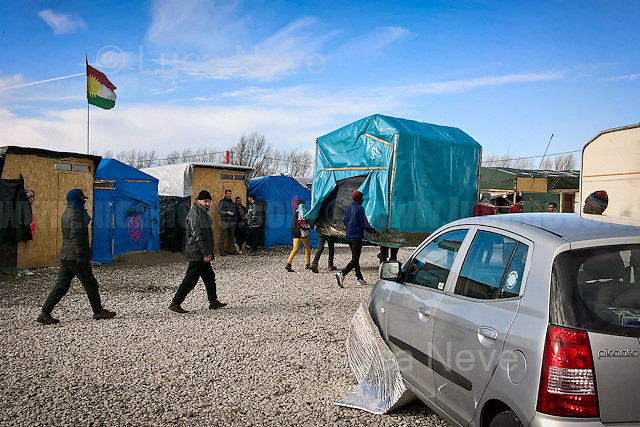 """Moving Home...<br /> <br /> Calais Jungle Camp.<br /> <br /> Under the Sky of Calais & Dunkirk. Two Camps, Two Sides of the Same Coin: Not 'migrants', Not 'refugees', just Humans.<br /> <br /> France, 24-30/03/2016. Documenting (and following) Zekra and her experience in the two French camps at the gate of the United Kingdom: Calais' """"Jungle"""" and Dunkirk's """"Grande-Synthe"""". Zekra lives in London but she is originally from Basra in Iraq. Zekra and her family had to flee Kuwait - where they moved for working reason - due to the """"Gulf War"""", and to the Western Countries' will to """"export Democracy in Iraq"""". Zekra is a self-motivated volunteer and founder of """"Happy Ravers"""", a group of people (not a NGO or a charity) linked to each other because of their love for rave parties but also men and women who meet up every week to help homeless people and other people in need in Central London. (Here there are some of the stories I covered about Zekra and """"Happy Ravers"""": http://bit.ly/1XVj1Cg & http://bit.ly/24kcGQz & http://bit.ly/1TY0dPO). Zekra worked as an English teacher in the adult school at Dunkirk's """"Grande-Synthe"""" camp and as a cultural mediator and Arabic translator for two medic teams in Calais' """"Jungle"""". Please read her story at the beginning of this reportage."""