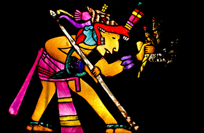 superp cover image of a colorfull aztec priest in stained glass, holding a sacrifisal knife and a spear foto, reise, photograph, image, images, photo,<br />