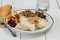 Classic Thanksgiving dinner: Roasted turkey with gravy, mashed potatoes, cranberry sauce, stuffing and roasted Brussels sprouts