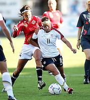 Charli Lloyd (11) battles for the ball against Norway's Ingvild Stensland. USA 4,  Norway 0, Fredrikstad Stadium, July 2, 2008.