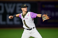 "Akron RubberDucks third baseman Nolan Jones (17) throws to first base during an Eastern League game against the Erie SeaWolves on August 30, 2019 at Canal Park in Akron, Ohio.  Akron wore special jerseys with the slogan ""Fight Like a Kid"" during the game for Akron Children's Hospital Home Run for Life event, the design was created by 11 year old Macy Carmichael.  Erie defeated Akron 3-2.  (Mike Janes/Four Seam Images)"
