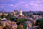 The spire of Harvard University's Lowell House rises above the Harvard Campus.  Boston can be seen in the background.