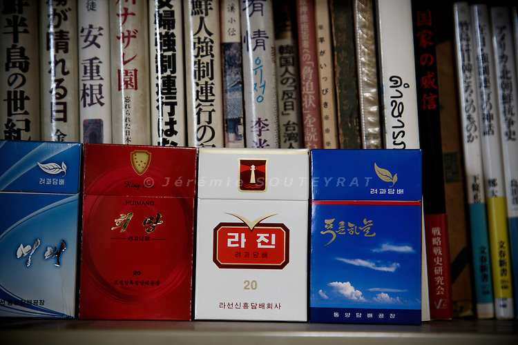 Tokyo, October 25 2012 - At the office of NARKN, National Association for the Rescue of Japanese Kidnapped by North Korea. Cigarettes form North Korea and books about North Korea.