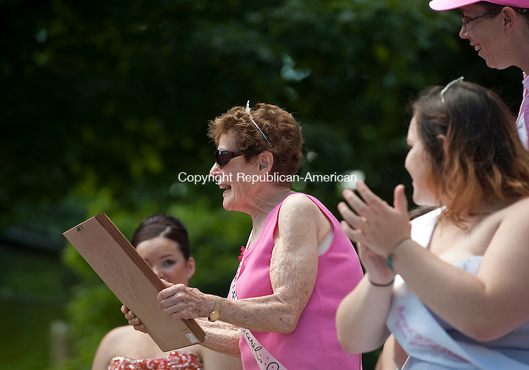 WINSTED, CT--061315JS08-  1936 Laurel Queen Virginia Hurlbut McMahon received a photo from the Laurel Committee during the 2015 Laurel Festival Parade and ceremonies in Winsted on Saturday.<br /> Jim Shannon Republican-American