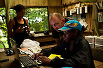 Jaguar (Panthera onca) biologists, Jizel Miles and Ian Thomson, looking at camera trap images, Coastal Jaguar Conservation Project, Tortuguero National Park, Costa Rica