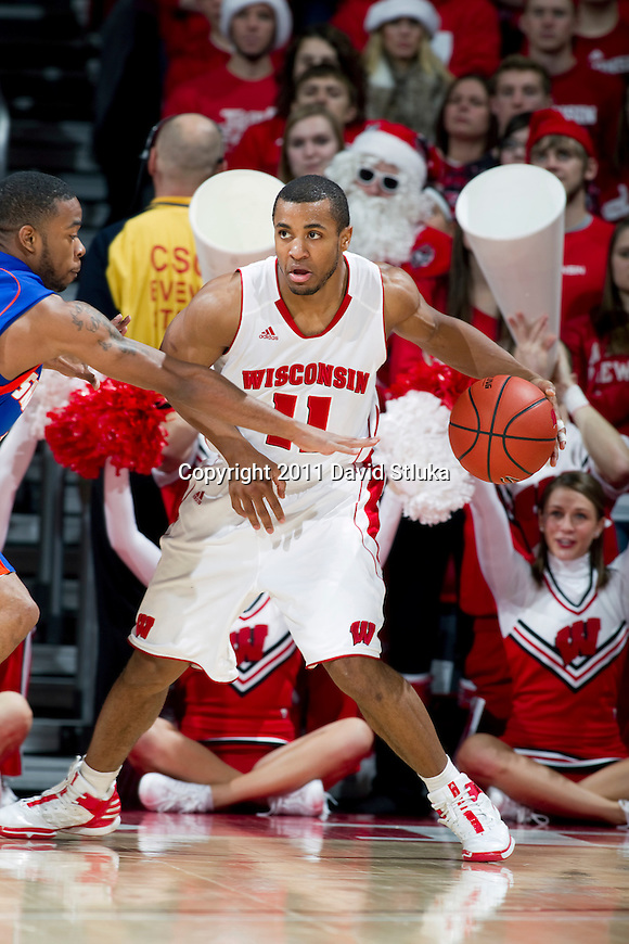 Wisconsin Badgers guard Jordan Taylor (11) handles the ball during an NCAA college basketball game against the Savannah State Tigers on December 15, 2011 in Madison, Wisconsin. The Badgers won 66-33. (Photo by David Stluka)