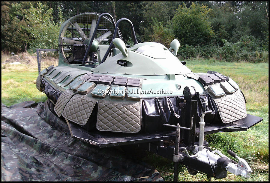 BNPS.co.uk (01202 558833)<br /> Pic: JuliensAuctions/BNPS<br /> <br /> ***Please Use Full Byline***<br /> <br /> The hovercraft that features in the James Bond film, Die Another Day. <br /> <br /> Est: &pound;30,000.<br /> <br /> The iconic micro-jet flown by Roger Moore in Octopussy and the swivel chair used by super-villain Blofeld are among a host of props from James Bond movies coming up for sale.<br /> <br /> The 12ft long BD-5J red, white and blue aircraft, that is the world's lightest jet, was piloted by 007 in the opening scenes of Octopussy, outwitting his Cuban captors.<br /> <br /> The aircraft was actually built seven years before the film as part of an air display team and was hired for the 1983 Bond flick.