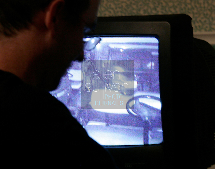 Scott Wilson sets up a video monitor at the Green Manor Restaurant in Union City, Ga. on Saturday night, Jan. 20, 2007. Several members of the West Georgia Paranormal Research Society spent the night at the house to investigate suspected activity. People have said the ghost of a woman, Florence Westbrook, is active in the historic home.