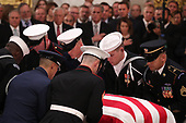 The casket of former U.S. President George H.W. Bush is delivered by a military honor guard to lie in state in the U.S. Capitol Rotunda as members of the U.S. House leadersip look on in Washington, U.S., December 3, 2018. REUTERS/Jonathan Ernst/Pool