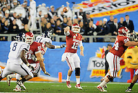 Jan. 1, 2011; Glendale, AZ, USA; Oklahoma Sooners quarterback (12) Landry Jones throws a pass in the second half against the Connecticut Huskies in the 2011 Fiesta Bowl at University of Phoenix Stadium. Mandatory Credit: Mark J. Rebilas-.