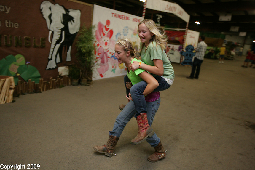 NW Washington Fair. Horse barn-Katy O'Flaherty, 18, of Lynden,gives her friend a ride (can get name) and Blazing Saddles (360-393-0578)-August 16, 2009 PHOTOS BY MERYL SCHENKER