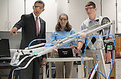 United States President Barack Obama visits a classroom and watches students Meghan Clark and Nathan Hughes (R) demonstrate the FIRST Robot, a robot created in the school's prototyping and robotics senior research labs for last year's FIRST Robotics Competition, at Thomas Jefferson High School for Science and Technology September 16, 2011 in Alexandria, Virginia. Later in the morning Obama signed the America Invents Act, which reforms patent law so to give a patent to the first applicant rather than the first inventor and allows the woefully underfunded U.S. Patent and Trade Office to set and potentially keep its own fees. .Credit: Chip Somodevilla / Pool via CNP