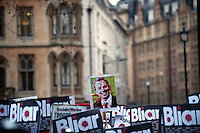 UK. London. 29th January 2010.Demonstrators against Tony Blair outside the Chilcot Inquiry where he was due to give evidence on the Iraq war..©Andrew Testa for the New York Times