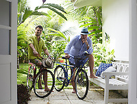 Designer Sig Bergamin and Murilo Lomas in the garden of their beach house