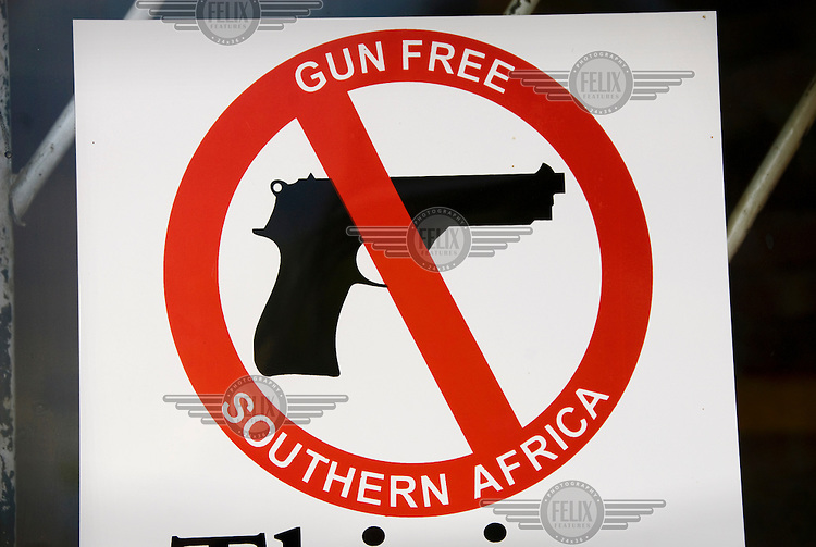 A sign reads 'gun free Southern Africa' at the Red Cross office in Maseru.
