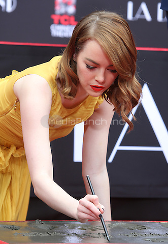 Hollywood, CA - DECEMBER 07: Emma Stone, At Ryan Gosling And Emma Stone Hand And Footprint Ceremony At TCL Chinese Theatre IMAX, California on December 07, 2016. Credit: Faye Sadou/MediaPunch